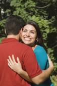 Hispanic couple hugging — Stock Photo