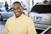 Car salesman smiling — Stock Photo