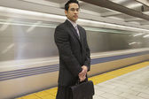 Businessman in front of subway — Stock Photo