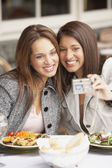 Two women taking a self-portrait at lunch — Stock Photo