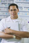 African American male pharmacist with chart — Stock Photo