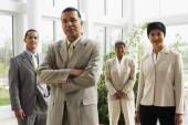 Businessman with coworkers in background — Stock Photo
