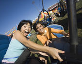 People riding a roller coaster — Stock Photo