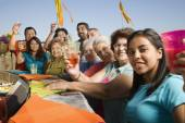 Large Hispanic family toasting at party outdoors — Stock Photo