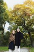 Senior couple smiling in park — Stock Photo