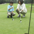 Mother teaching son to play golf — Stock Photo #52030731