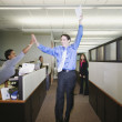 Businesspeople cheering in office — Stock Photo #52030855