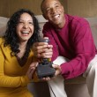 Multi-ethnic couple playing video game — Stock Photo #52030961