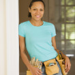 African woman wearing tool belt — Stock Photo #52031389