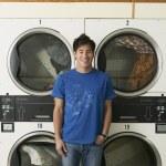 Asian man in Laundromat — Stock Photo #52031409