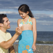 Hispanic father and daughter looking at seashell — Stock Photo #52031575