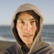 Asian man wearing hooded sweatshirt — Stock Photo #52031687