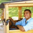 Hispanic man driving old fashioned car — Stock Photo #52031779