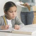 Young girl doing her homework — Stock Photo #52032375
