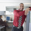 Businessman smiling for the camera in office space — Stock Photo #52032701