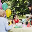 Hispanic girl receiving gifts at birthday party — Stock Photo #52033073