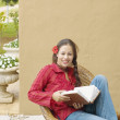 Woman reading book outdoors — Stock Photo #52033217