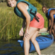 Young woman smiling with canoe — Stock Photo #52033361