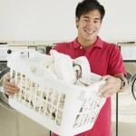 Asian man in laundromat — Stock Photo #52033369