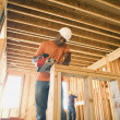 African male construction worker using saw — Stock Photo #52033507