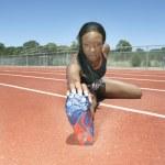 Female track athlete stretching — Stock Photo #52034433