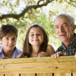 Hispanic family smiling outdoors — Stock Photo #52035481