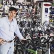 Man standing in bike shop — Stock Photo #52036139