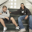 Two young men laughing on stairs at school — Stock Photo #52036211