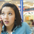 Hispanic teenage girl talking on cell phone — Stock Photo #52036267