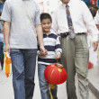 Asian grandfather, father and son walking on sidewalk — Stock Photo #52037217