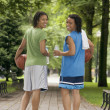 Постер, плакат: Two teenage girls with basketballs