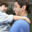 Hispanic father and son smiling at each other — Stock Photo #52038247
