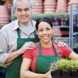Hispanic couple working at garden center — Stock Photo #52039433