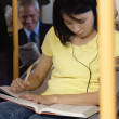 Teenager doing homework on subway — Stock Photo #52039741