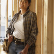 Asian female construction worker inside construction site — Stock Photo #52039787