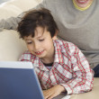 Hispanic brothers looking at laptop — Stock Photo #52039967