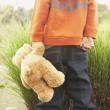 Young boy with teddy bear — Stock Photo