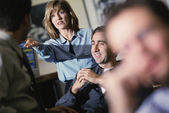 Co-workers talking — Stock Photo