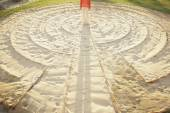 Person standing in the middle of a meditation labyrinth — Stock Photo