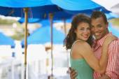Young couple hugging at beach — Stock Photo