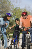 Hispanic parents and son riding bicycles — Stock Photo