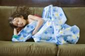 Asian girl sleeping on sofa — Stock Photo