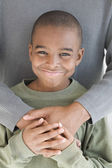 African boy getting hug from father — Stock Photo