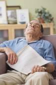 Senior Hispanic man sleeping on sofa — Stock Photo