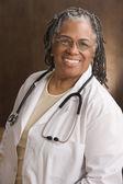 Female doctor smiling — Stock Photo
