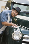 Middle-aged Hispanic man waxing classic car — Stock Photo