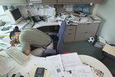 Businessman sleeping at desk — Stock Photo