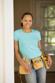 African woman wearing tool belt — Foto de Stock