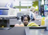 Girl at checkout line — Stock Photo