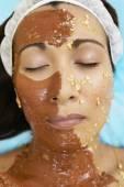 Asian woman receiving spa facial treatment — Stock Photo